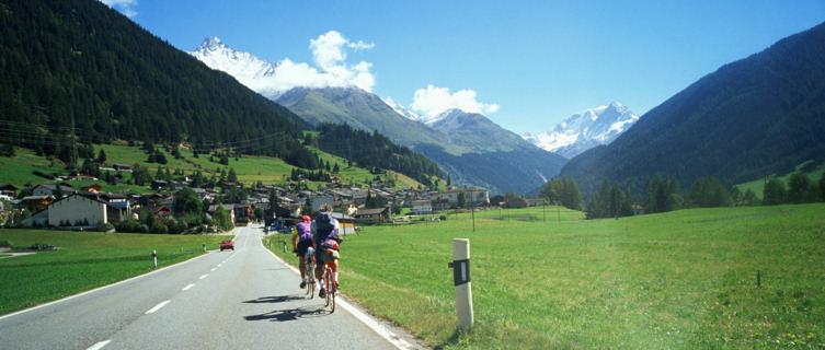 Cycle past beautiful scenery in Switzerland