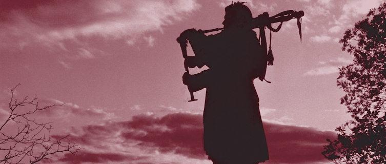 Scottish Highlander playing bagpipes